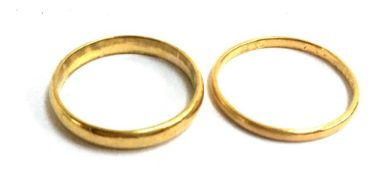 A 22ct wedding band, 3.5g, size P, together with further gold band (hallmarks rubbed) 1.5g, size O.5