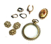 A yellow metal picture pendant, small horseshoe charm, small enamel painted brooch and others