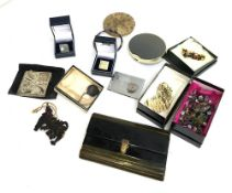 Mixed lot including a Vanity Fair compact, manicure set, 2 bead necklaces, enamel bangle, stamp