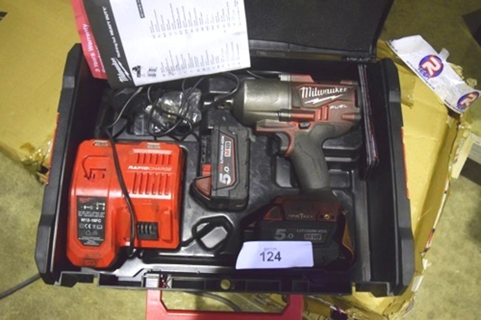 Lot 124 - Milwaukee cordless 18V nut runner and charger and 2 batteries in total - Customer return (GS26)