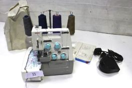 A Toyota differential overlocker sewing machine, model SL1T, comes with power cable, pedal, dust