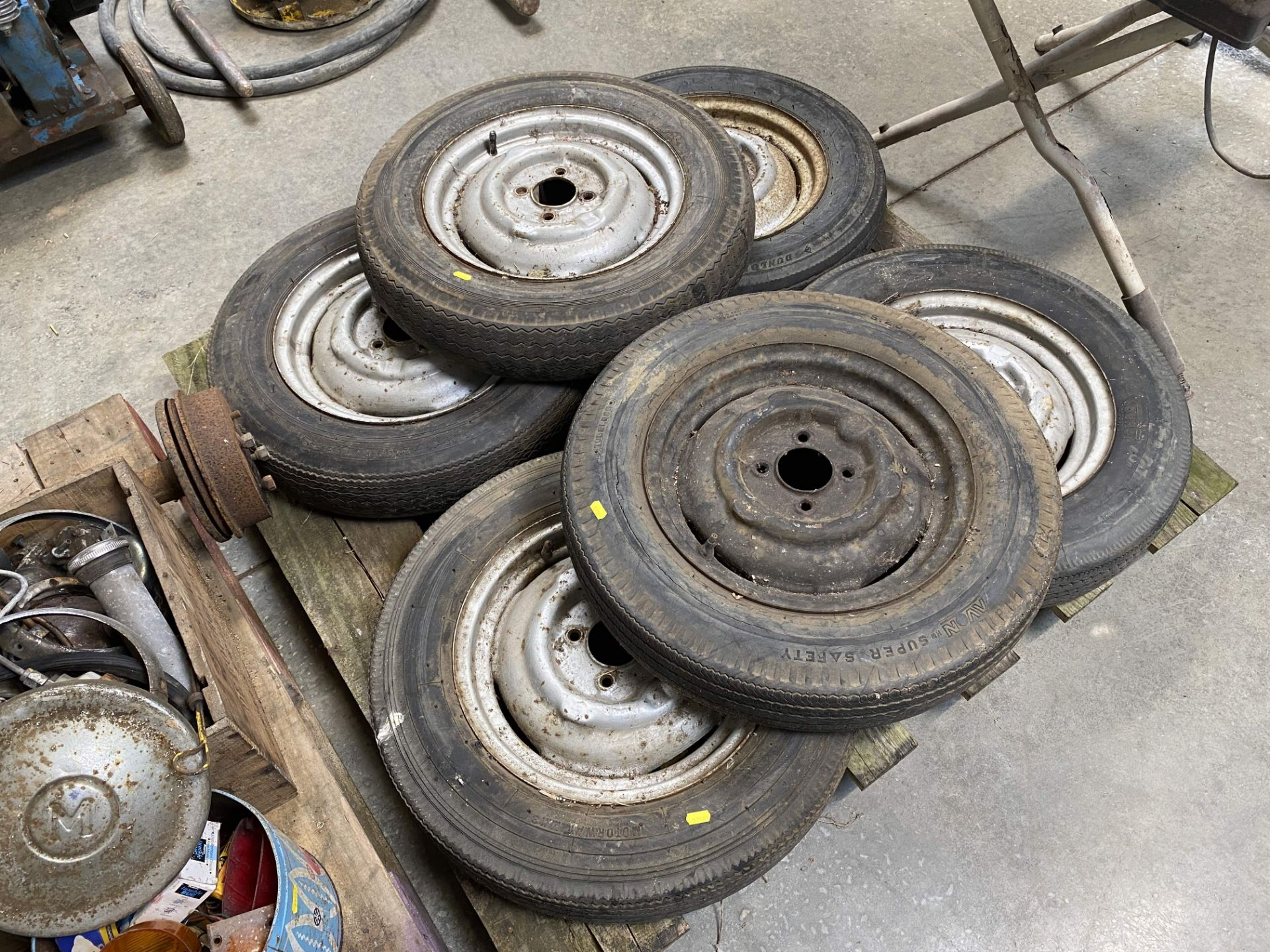 Lot 139 - Morris Minor rear axle, clutch, springs, wheels and tyres and various spares.