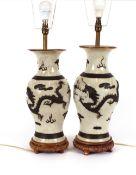 A pair of antique Chinese baluster vases, converted to table lamps, decorated bronzed raised