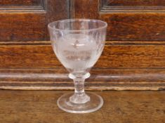 "A Masonic etched wine glass, decorated with various symbols, inscribed ""INRI"" and initialed with a"