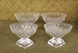 A set of four Antique cut glass pedestal salts, of boat shape, raised on faceted bases with