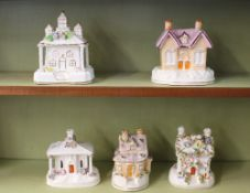 Five various Victorian Staffordshire and Coalport pastille burner cottages, mostly with floral