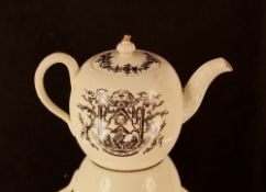 A rare and unusual Masonic creamware bullet shaped teapot, decorated with symbols, the spout and