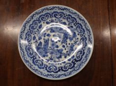 A Chinese blue and white shallow dish, the central field decorated with flowers, 20.5cm dia. six