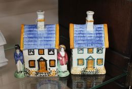An Antique Staffordshire pearlware cottage moneybox, decorated with figures beside a cottage, 13cm