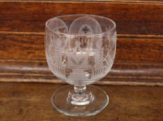 A Masonic etched glass rummer, decorated with symbols, raised on a circular spread foot, 12.5cm