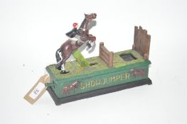 "A novelty cast iron moneybox, ""Show Jumper"""