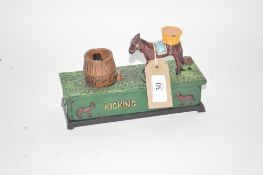 "A novelty cast iron moneybox, ""Kicking Mule"""