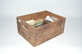A Vintage wooden advertising crate and contents of