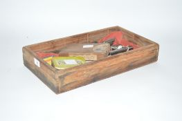 A wooden tray containing various taps and dies inc