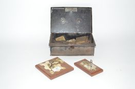 A tin box containing Vintage trunk locks and two e