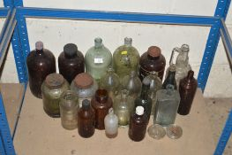 A collection of various Antique bottles and jars i