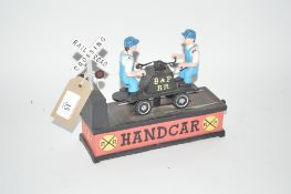"A novelty cast iron moneybox, ""Hand Car"""