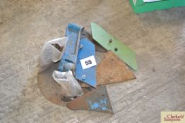 Ransomes left-hand plough disc and wearing metal.