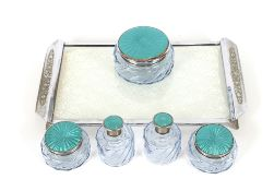 An Art Deco blue tinted glass and faux enamel part