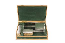 A cased Art Deco silver engine turned decorated dr