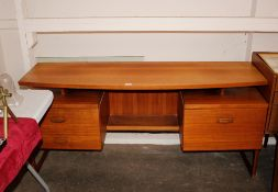 A teak G-plan dressing table of curved form with r