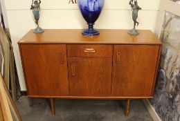 A teak G-plan sideboard fitted central drawer and