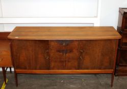 A teak sideboard fitted three central drawers, fla