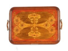 A walnut Art Nouveau two handled tea tray with sty