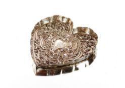 A small silver heart shaped pin dish, having folia