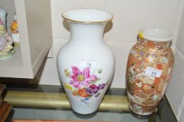 A KPM floral decorated vase