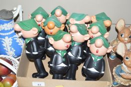 A collection of Avon Andy Capp dispensers