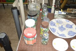 A very large quantity of various glass marbles in jars