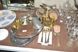 A pair of brass candlesticks; silver plated trays;