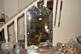 A Venetian style wall mirror with etched decoratio