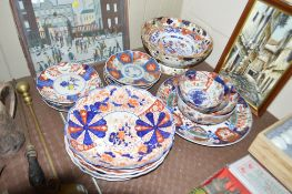 A large quantity of Japanese Imari plates and bowl