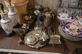 A quantity of silver plated ware to include candle