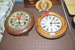 A metal cased single hole wall clock and a Victor