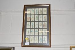 A framed set of Players cigarette cards depicting