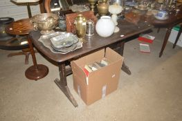 An Ercol dining table; and a set of four ladder ba