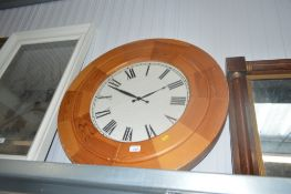 A large pine cased wall clock