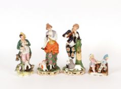 A pair of 19th Century Derby type figures, of a shepherd and shepherdess, on floral encrusted