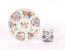 A Japanese Imari pattern plate, decorated flowers and vignettes of mythological beasts; and a