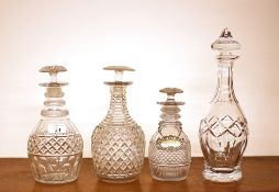 Three hobnail cut ring neck decanters, having mushroom stoppers; and a baluster shaped cut glass