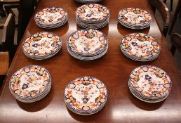 A quantity of Ashworths stone china dinnerware, including soup plates, dinner plates, and side