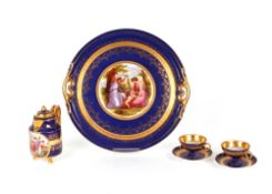 A Vienna porcelain part cabaret set, comprising tray, chocolate pot, and two cups and saucers