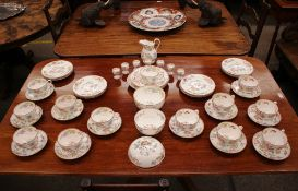 """A Minton """"Chinese Rose"""" pattern tea set including cups, saucers, milk jug, muffin dish, slops bowl"""