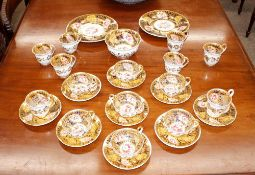 A Chamberlain Worcester tea set, comprising tea cups, coffee cups and saucers, slops bowl, and a