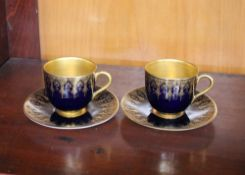 Six Royal Worcester cobalt blue and gilt decorated coffee cans and saucers