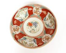A large Imari shallow dish, decorated in traditional palette, six character mark to base, 37cm dia.