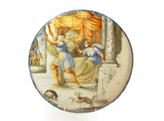 An 18th Century Majolica charger, decorated figures in a temple setting, guards in the far ground,